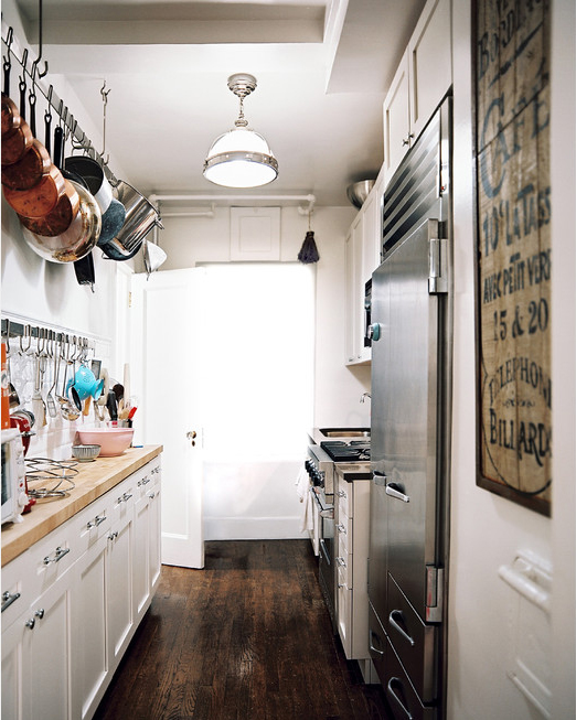 hanging pot rack in a small kitchen