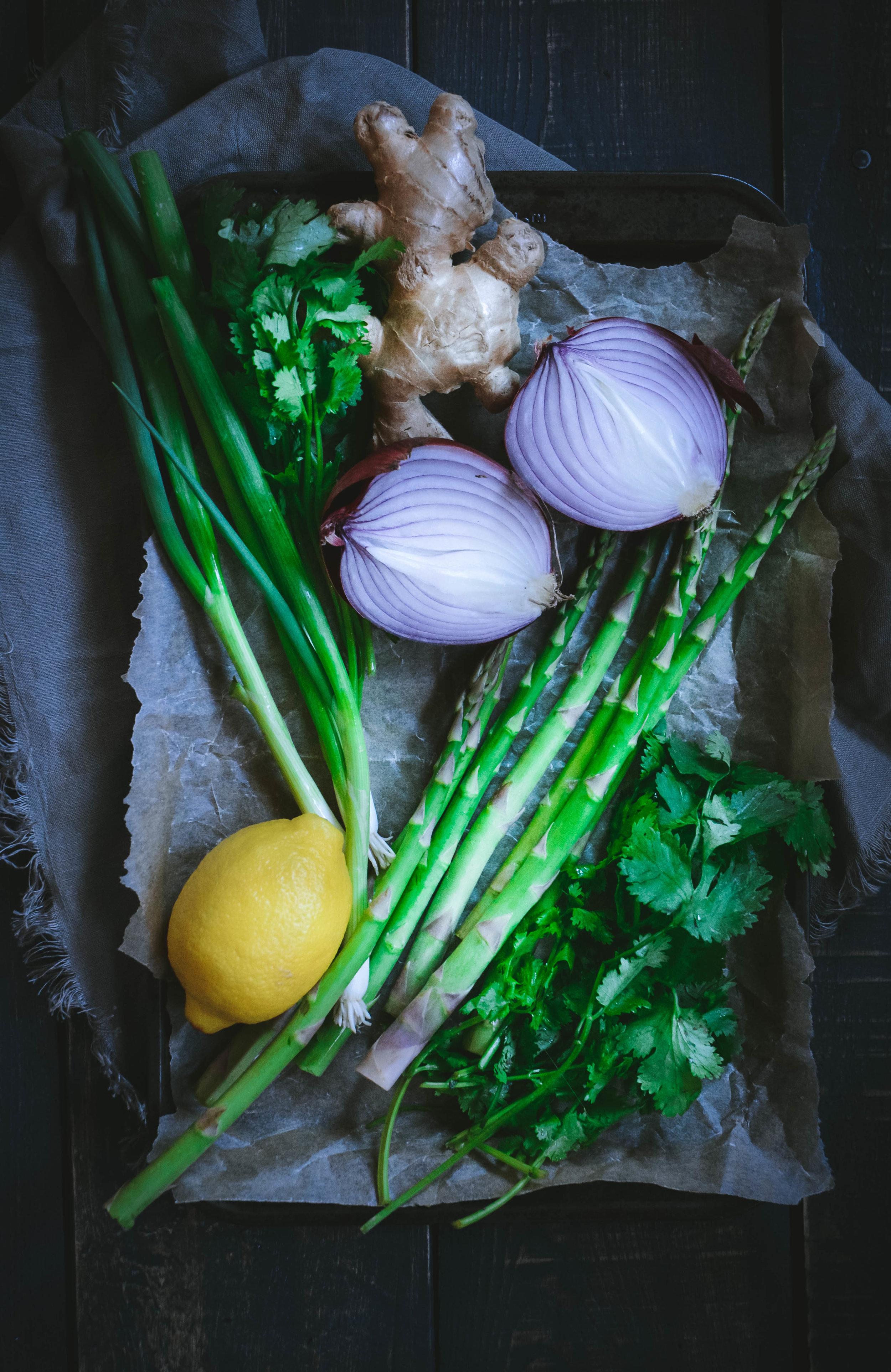 lemon, ginger, asparagus, green onion, cilantro on roasting tray