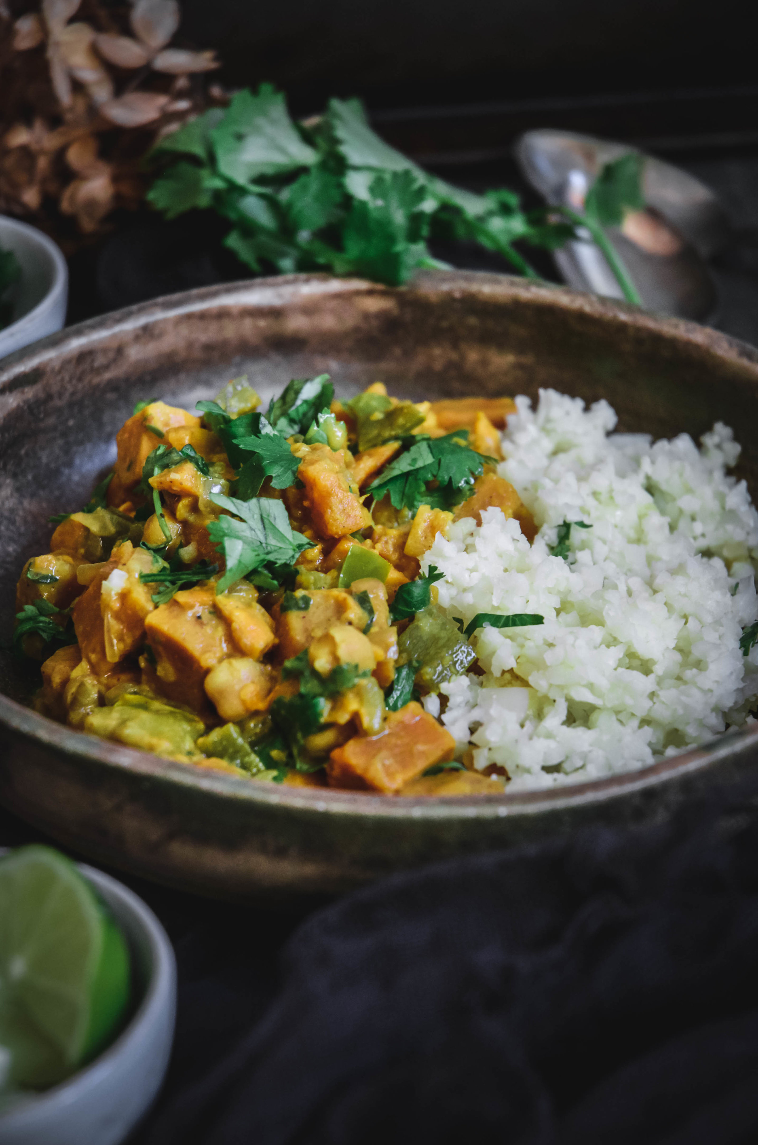 Sweet potato curry in bowl with cauliflower rice