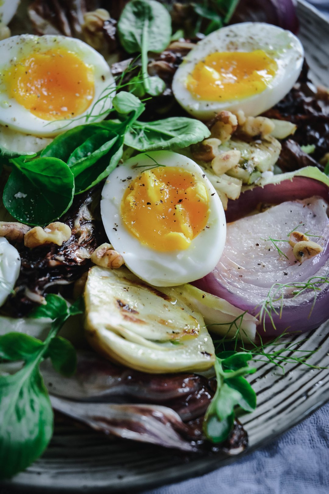 Soft boiled eggs on salad