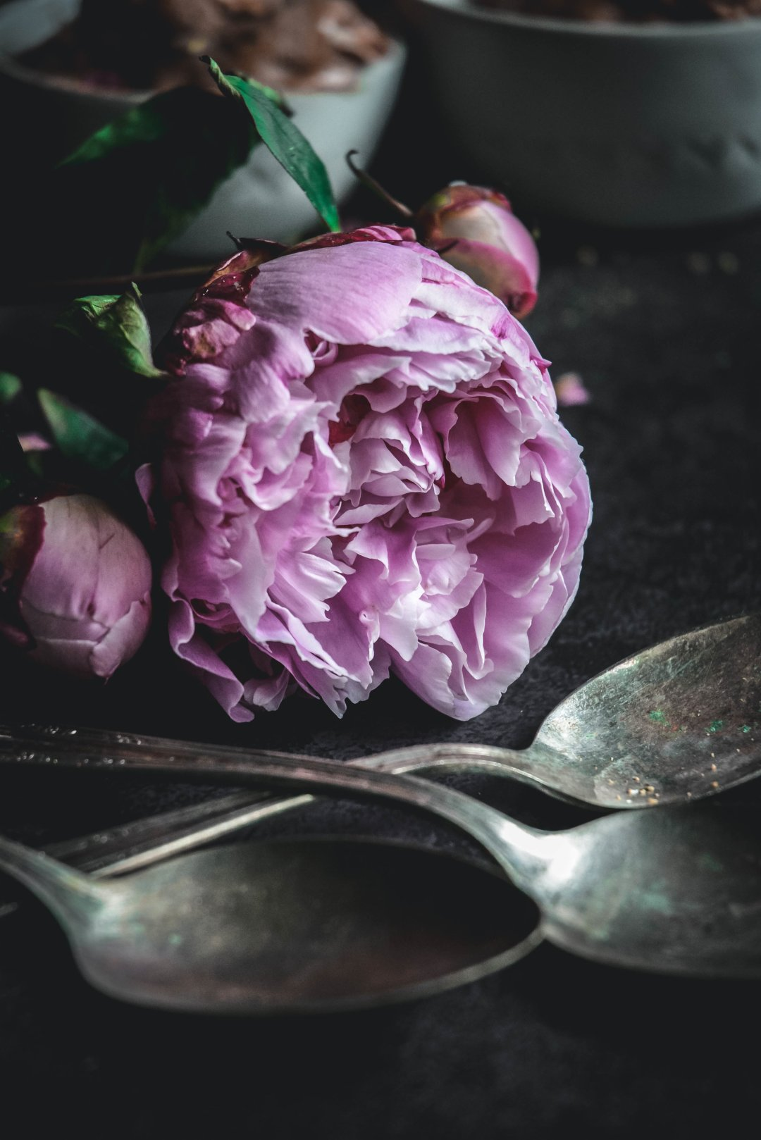 peony and spoons on table