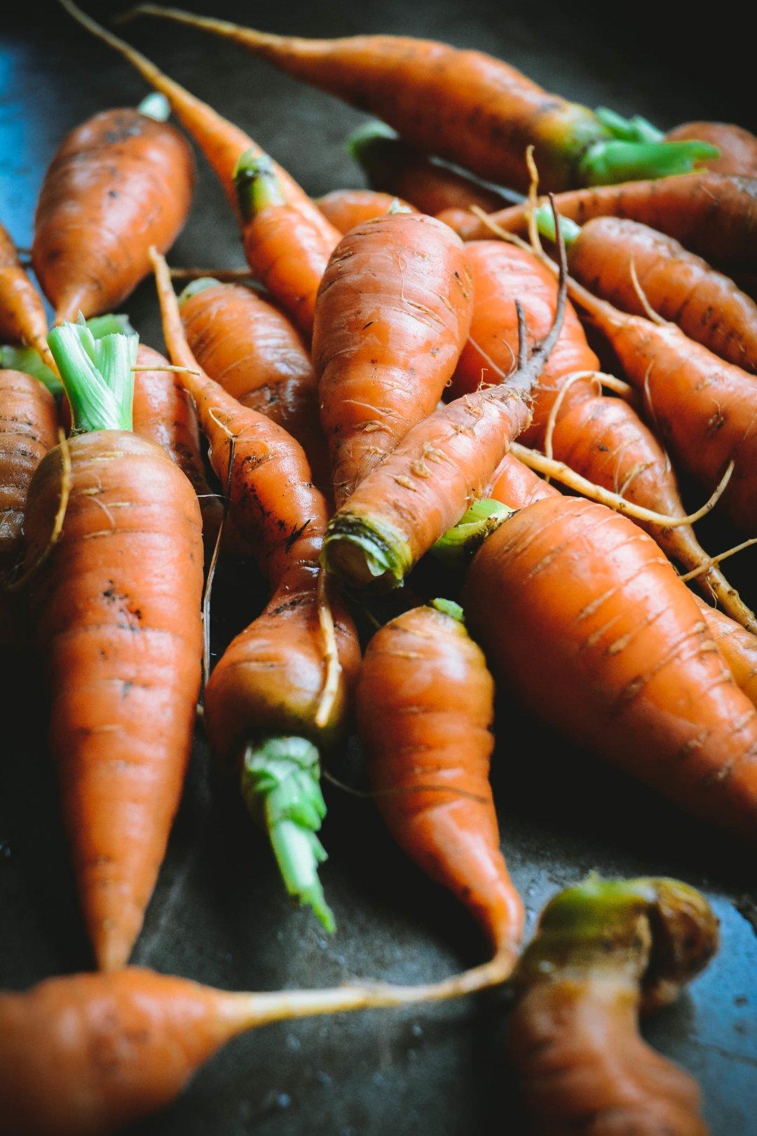 Fresh carrots on tray