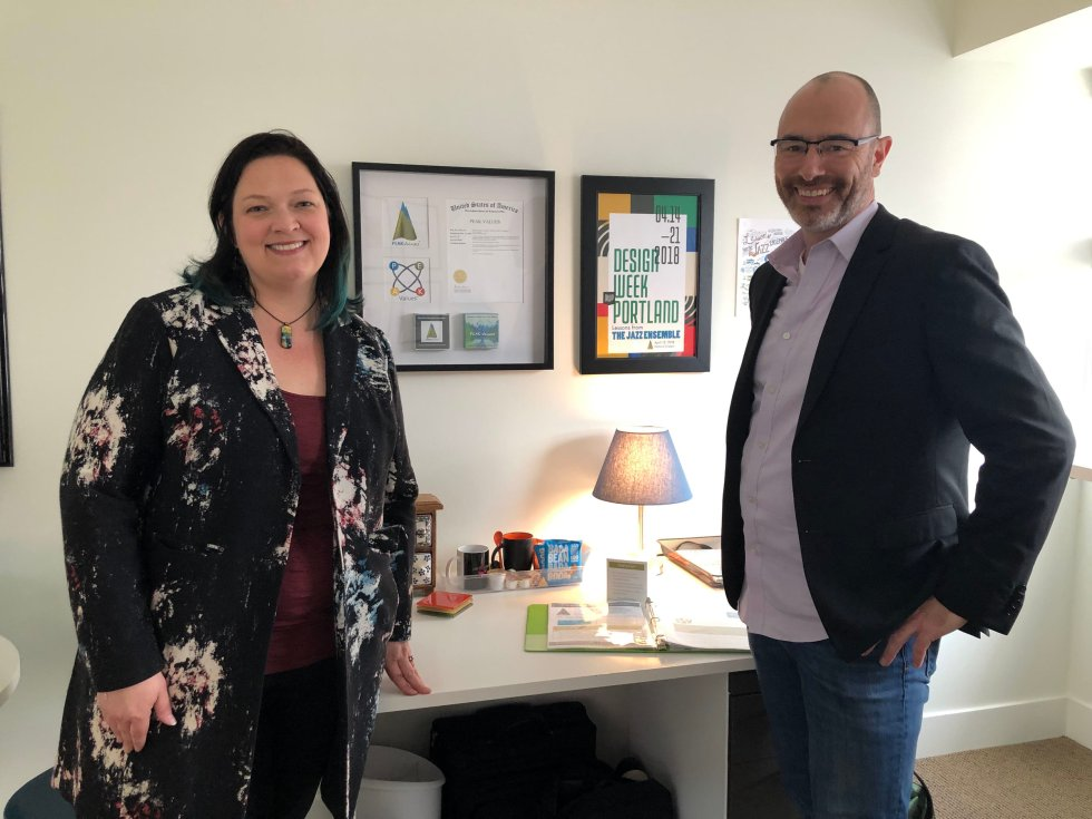 Jen Coyne and Brian Stinson, Co-Founders of The Peak Fleet, getting ready for an open house during Design Week in their Portland office.