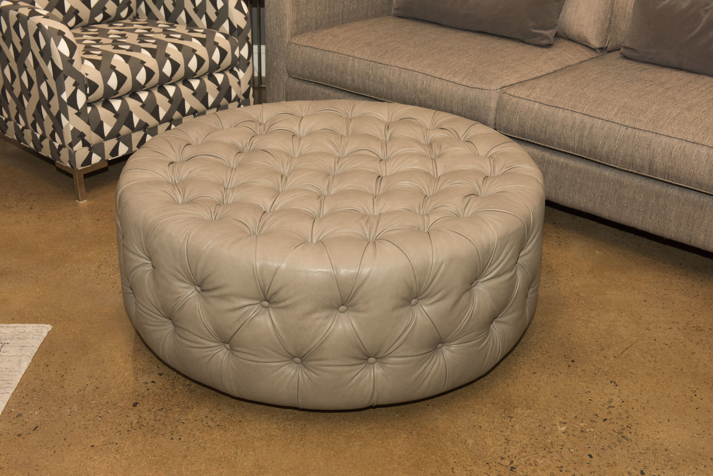 customizable leather round tufted carmen ottoman miller s home furnishings