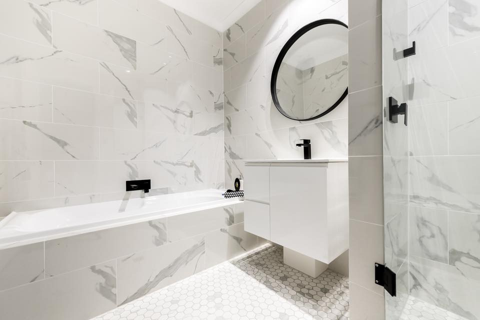natural stone vs marble look tiles