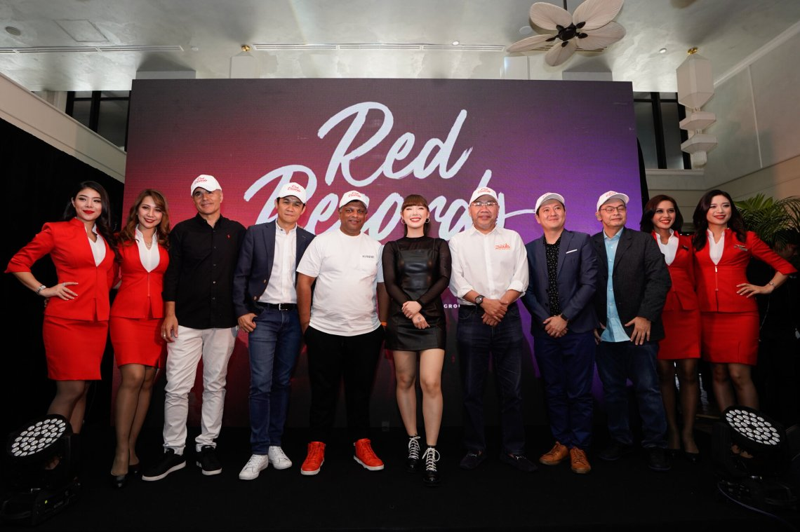 (Third from left) Hassan Choudhury, Head of Music for AirAsia Group and CEO of RedRecords; Calvin Wong, CEO South East Asia and Senior Vice President, Asia - Universal Music Group; Tony Fernandes, CEO of AirAsia Group; Jannine Weigel, Red Records first signing artist; Datuk Kamarudin Meranun, Executive Chairman of AirAsia Group; Kenny Ong, Managing Director of Universal Music Malaysia; and Nadda Buranasiri CEO of AirAsia X Group at the launch of RedRecords.
