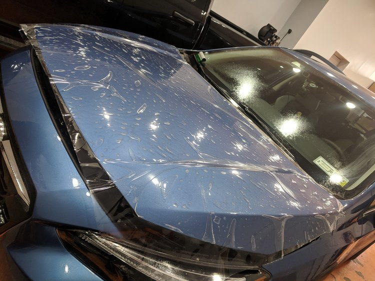 Subaru Crosstrek getting complete hood coverage with Suntek Ultra paint protection film