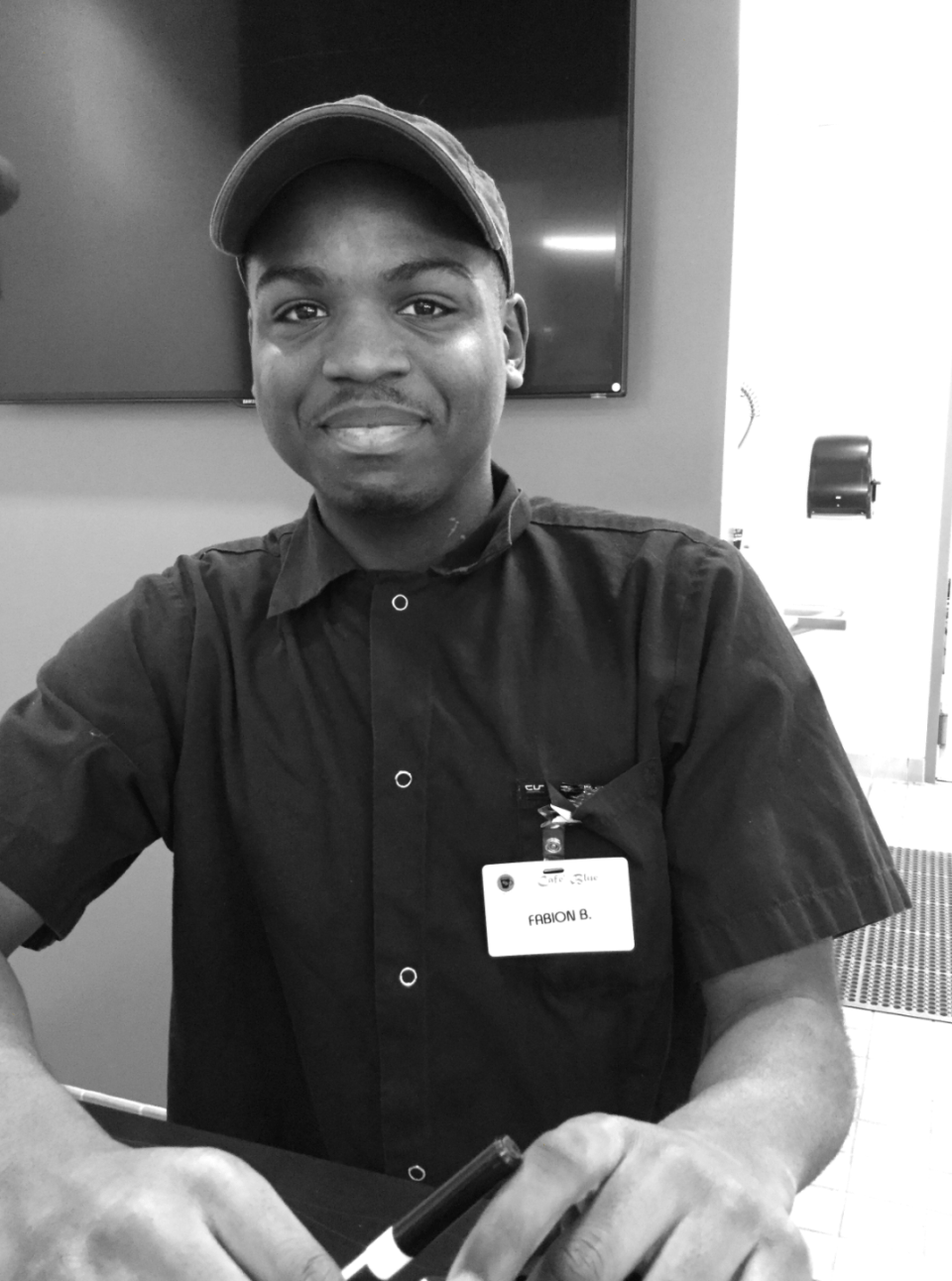 Student photograph of peer in the cafe, Inspiring and Representing Occupational Pride Through Photography, 2020