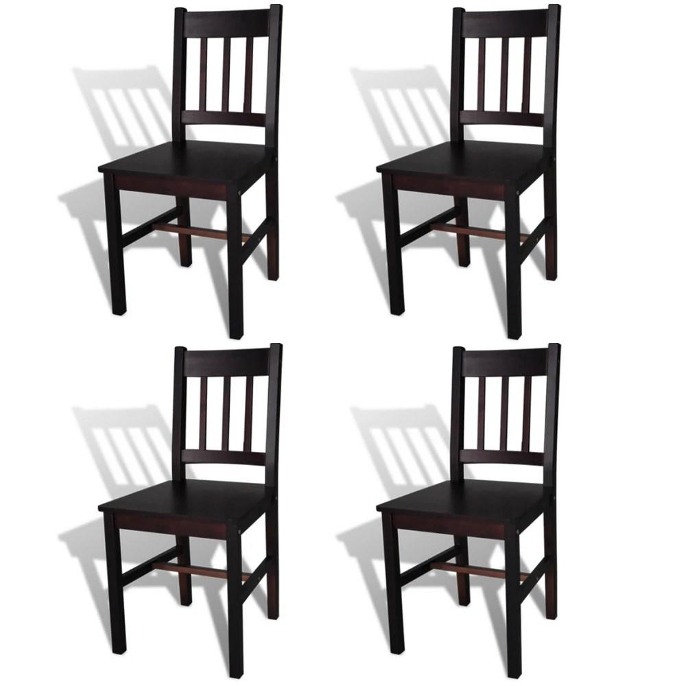 4 sillas marrones de comedor hechas de madera de pino