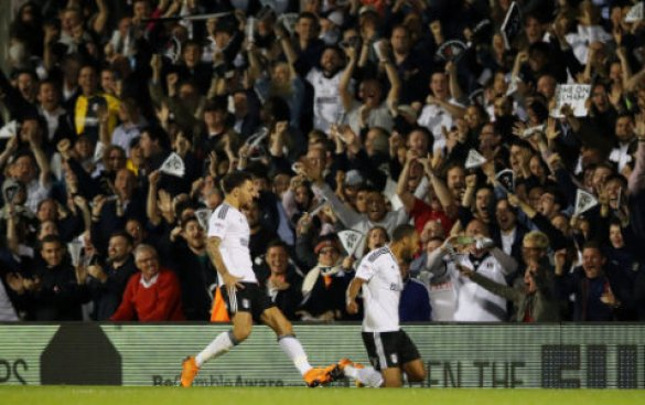 Fulham's Dennis Odoi celebrates scoring his side's second goal of the game in front of the fans during the Sky Bet Championship Playoff match at Craven Cottage, London.