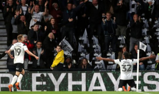 Derby County's Cameron Jerome (right) celebrates scoring his side's first goal of the game during the Sky Bet Championship Playoff match at Pride Park, Derby.