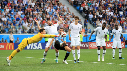 France goalkeeper Hugo Lloris punches clear from Uruguay's Cristhian Stuani