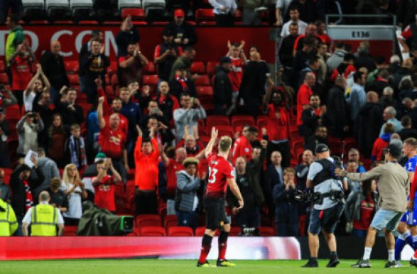 Manchester United's Luke Shaw waves to the fans during the Premier League match at Old Trafford Stadium, Manchester. Picture date 10th August 2018. Picture credit should read:…