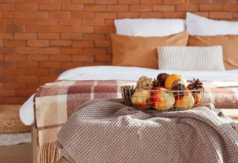 fall bedroom with pumpkin