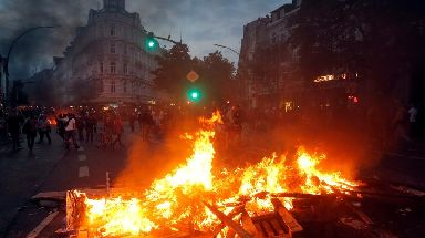 A barricade is set on fire during a protest against the G-20 summit in Hamburg, northern Germany.