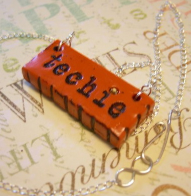 "Pendant with ""Techie"" label"