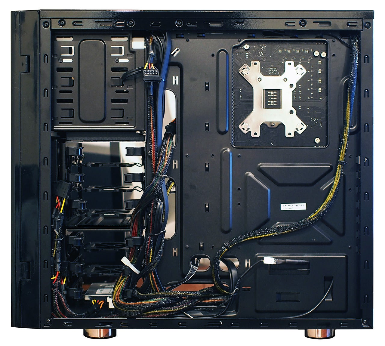 hight resolution of a behind the motherboard glimpse at a cleanly cabled system