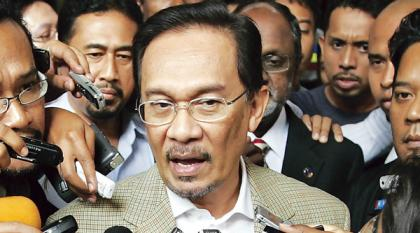 Anwar Ibrahim speaks to the media shortly before being arrested. He had been about to go to Kuala Lumpur police headquarters for questioning over sexual assault allegations.