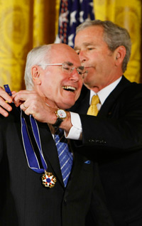 Dr. Death Squad being awarded the now ironically named Medal of Freedom by still-President Bush.