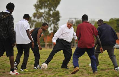 James Demetriou plays the other football with African refugees