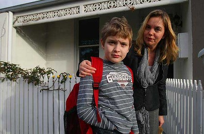 "Stephanie Gotlib, with son Adam, says conditions on buses servicing specialist schools are ""inhumane"". <i>Picture: Craig Sillitoe</i>"