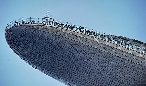 Visitors take in the view from the SkyPark at Marina Bay Sands in Singapore.