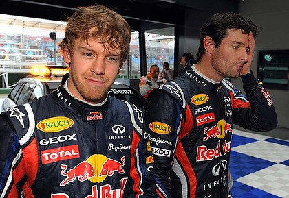 Sebastian Vettel smiles after securing pole position while teammate Mark Webber sports a more sober expression after securing the third spot on the grid.