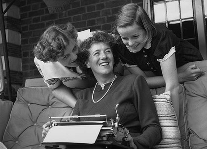 Enid Blyton with her two daughters Gillian and Imogen at their home in Beaconsfield, Buckinghamshire.