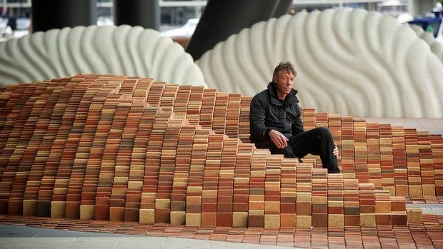 Natural flow: Mark Stoner at his installation <i>The River Runs through It</i>, which spreads from the western tip of Collins Street to the Docklands water's edge.