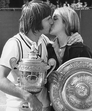 Jimmy Connors kisses his fiancee Chris Evert after winning the men's singles final at Wimbledon on July 6, 1974. Evert had just won the women's singles.