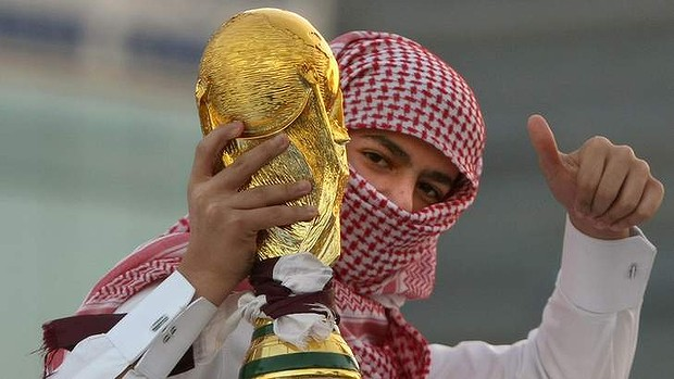 A Qatari youth holds a mock World Cup trophy during celebrations in Doha, a day after the world football's governing body FIFA announced that the tiny Gulf state will host the 2022 World Cup.
