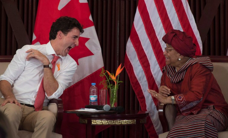 Canadian Prime Minister Justin Trudeau shares a laugh with Liberian President Ellen Johnson Sirleaf in Liberia in November 2016. Credit: The Canadian Press/Adrian Wyld