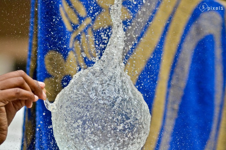 Water balloon just after it's pricked. At this moment, water acts like a solid for a very short period. Sunil Soundarapandian/Flickr, CC BY