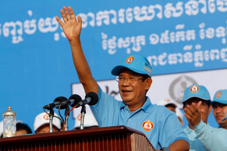 Cambodian Prime Minister Hun Sen waves to supporters just before the July 29 election. Photo:AP/Heng Sinith