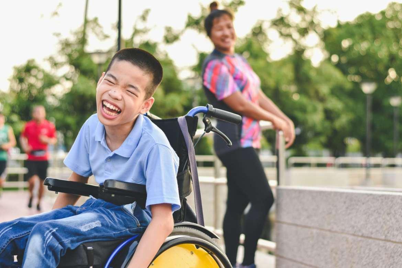 Smiling boy in wheelchair