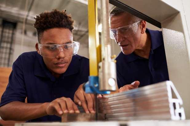 Carpenter training male apprentice