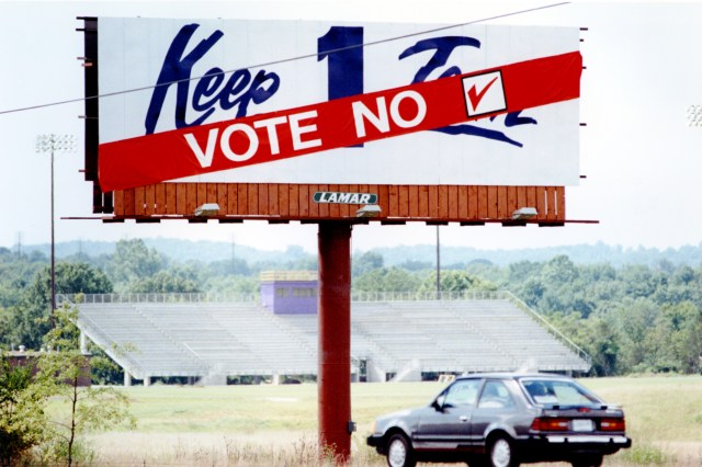 A banner that read 'Vote no' was added to billboards that read 'keep 1 team' near a Nissan plant in Smyrna, Tenn.