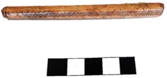 Brown flute-like tube with etchings on it.