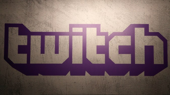 The purple logo of Twitch on a wall.