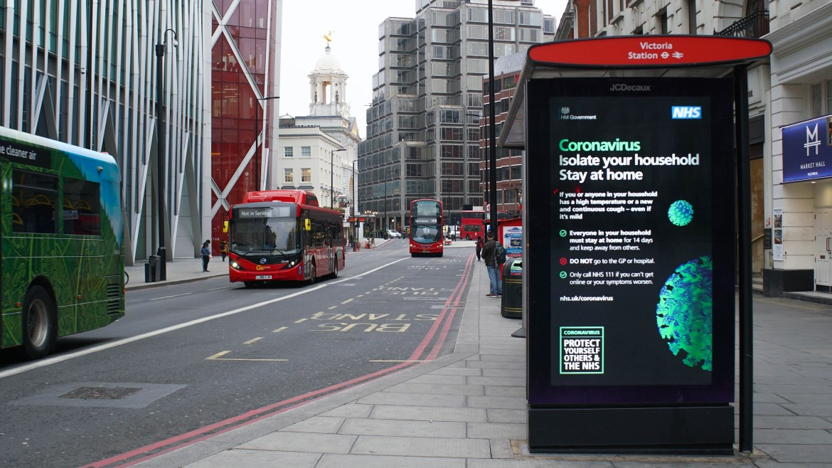 A sign on a London street tells people to stay at home during the pandemic.