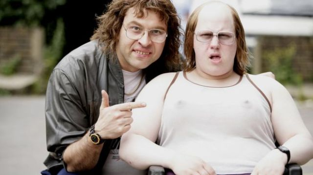 Actors David Walliams, pointing, and Matt Lucas, in a wheelchair.