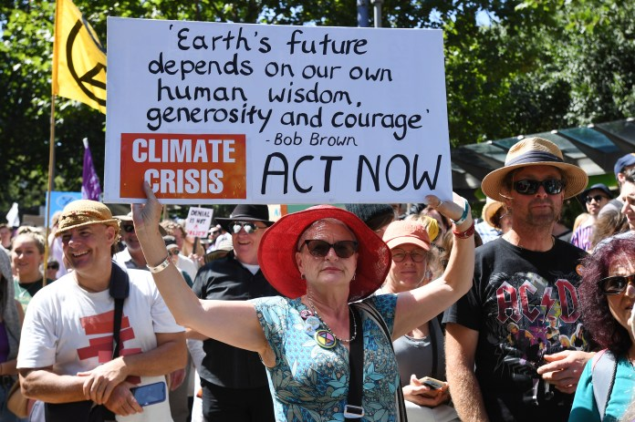 Woman holds a sign at a climate protest