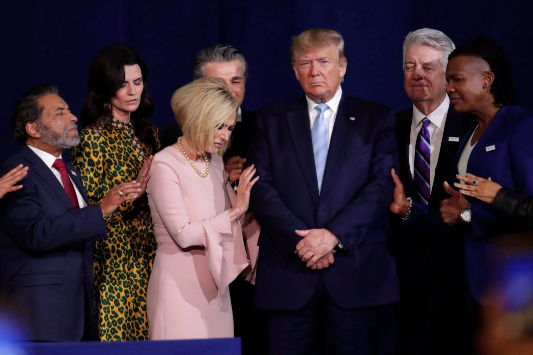 Trump is surrounded by evangelical Christians as they pray.