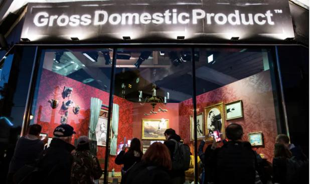 Image of Gross Domestic Product a shop window in Croydon showing graffiti artist Banksy's merchandise.