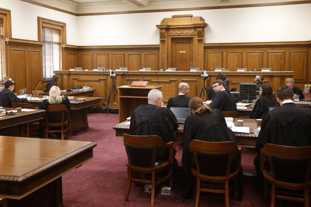 An image of a courtroom with a raised judges' platform.