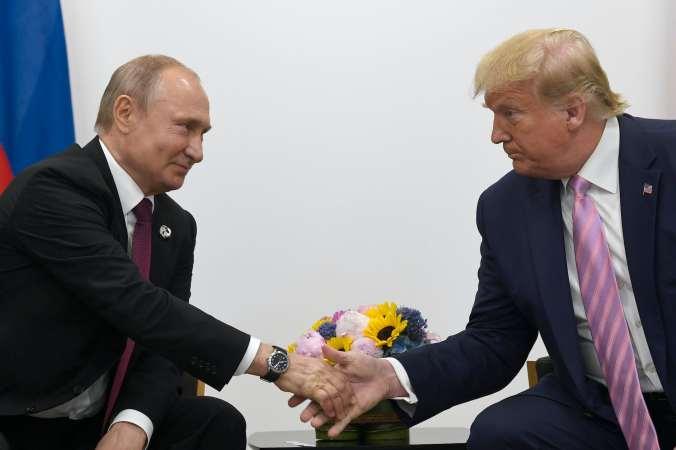 Vladimir Putin and Donald Trump shake hands