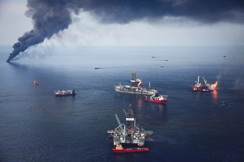 Large oil platform burning at sea.