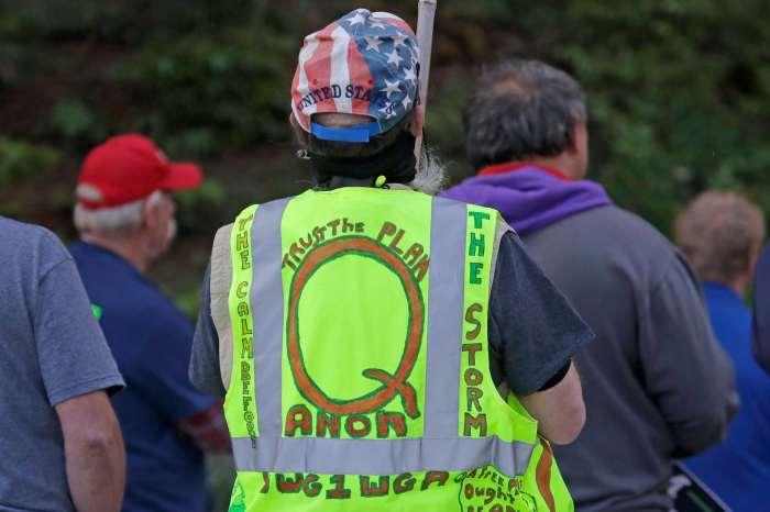 A person wearing a 'Q' vest