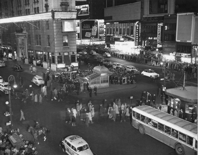 A sign and TV in Times Square on election night, 1948