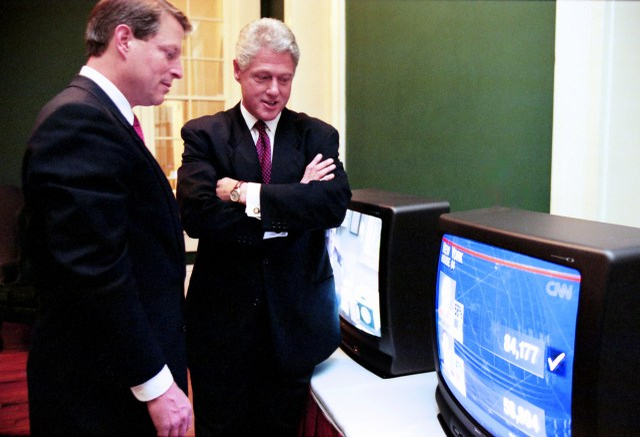 Al Gore and Bill Clinton watch TV